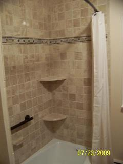 Canton Michigan Bathroom corner shelves travertine tile